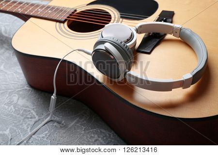 Classical guitar and headphones, close-up