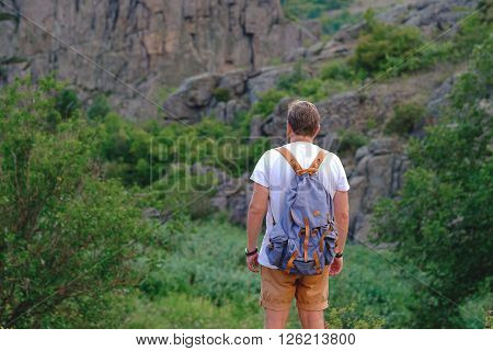 Young Man With Beard Standing On The Precipice Of Canyon