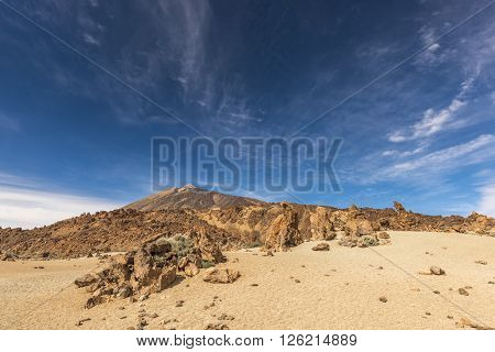 Blue sky over a stone desert at the foot of the volcano Teide on Tenerife.