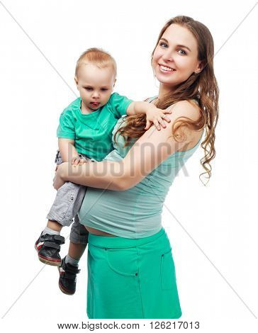 happy beautiful pregnant mother with her one year old son, studio shot