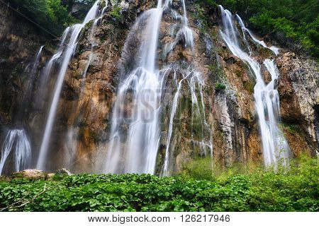view of beautiful waterfalls on slopes of mountains