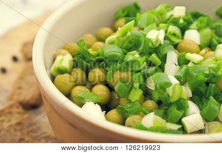 Canned Peas With Chives In Ceramic Bowl On Wooden Background. Healthy Breakfast. Healthy Food Concep