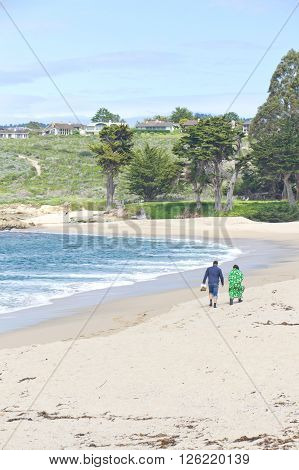 Couple Walking At Beach On Garrapata State Park, California