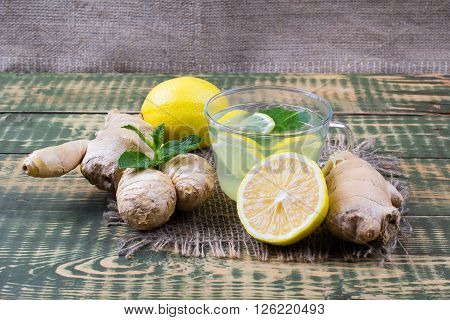 Drink about ginger and lemon juice on an old table
