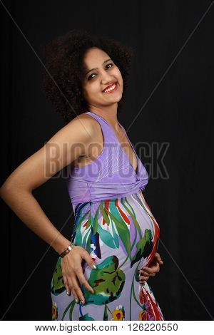 young pregnant woman with a dress at home