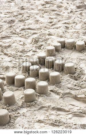 Mud pies on beach on summer, France