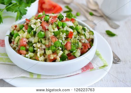 Salad with vegetables green beans and bulgur
