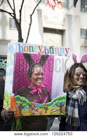 NEW YORK - MAR 27 2016: A woman wearing a replica chocolate Honey Bunny candy box costume on 5th Avenue Easter Sunday at the traditional Easter Bonnet Parade in Manhattan on March 27, 2016.