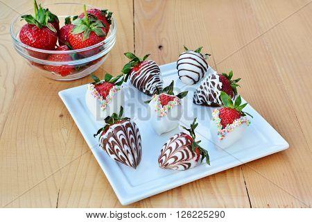 Chocolate dipped strawberries, white and dark chocolate covered, decorated strawberries.