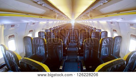 Interior passenger airliner cabin. empty aircraft cabin.