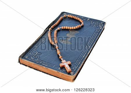 Old Book of Psalms and rosary isolated