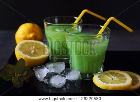 Cactus juice lemons and ice on a dark background