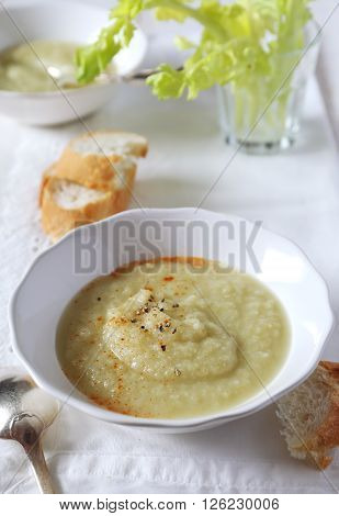 Vegetable celery soup in a white bowl