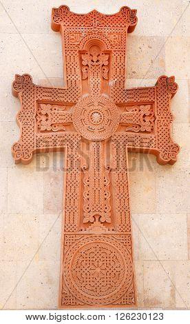 Ornamental stone Christian cross in the Temple