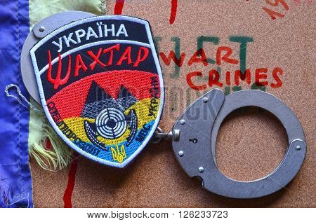 ILLUSTRATIVE EDITORIAL.Chevron of Ukrainian nazionalist battalion Miner in Police.The battalion disbanded for looting,pederastic rapes and torture. At April 17,2016 in Kiev, Ukraine