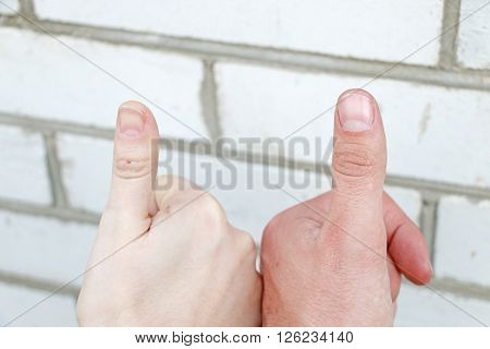 two hands touching show thumbs up success means ** Note: Visible grain at 100%, best at smaller sizes