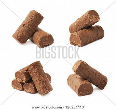 Pile of chocolate praline candies isolated over the white background, set of four different foreshortenings