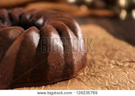 Chocolate cake on craft paper, closeup