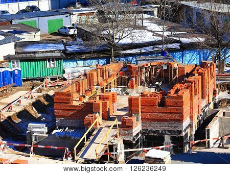 Construction of a building from red brick