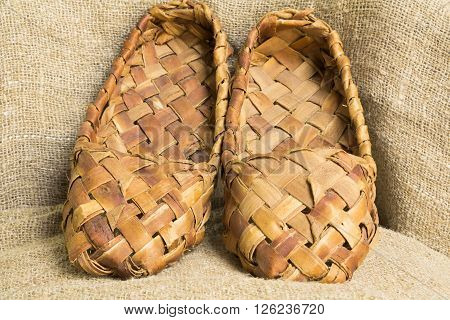 souvenir vintage Russian bast shoes amid Brown burlap