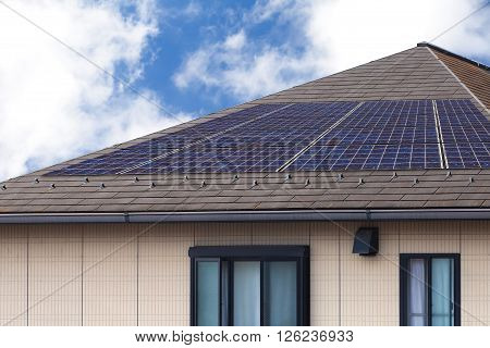 Solar panal roof on house and nice sky