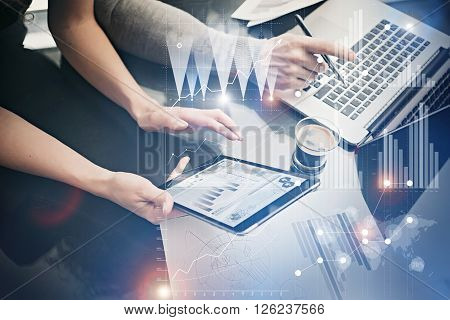 Photo female hands holding modern tablet. Risk managers working new private banking project in office. Using electronic devices. Graphics icons, worldwide stock exchanges interface.