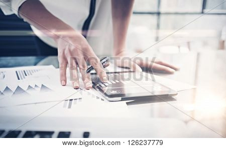 Photo woman reading market reports modern tablet and touching screen with worldwide stock exchange icons. Working process office. Horizontal. Film and blurred