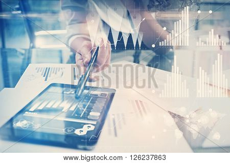 Image of working process. Finance director work new global project in worldwide bank office. Using modern tablet. Graphics icons, tax, stock exchanges interface.
