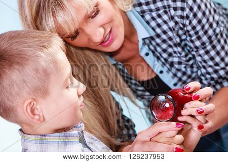 Child With Mother Hold Apple And Magnifying Glass.
