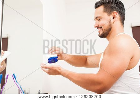 Young Man Using Cream For His Skin