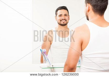 Young Man In Front Of A Bathroom Mirror