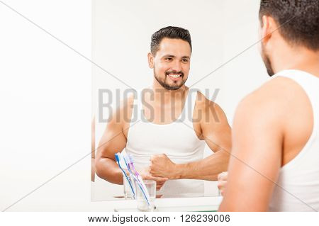 Strong Man In Front Of A Bathroom Mirror