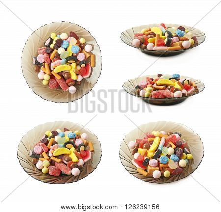 Glass plate full of candies isolated over the white background, set of five different foreshortenings