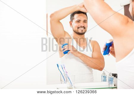Handsome Guy Putting On Some Deodorant