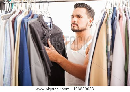 Handsome Man Looking At His Closet