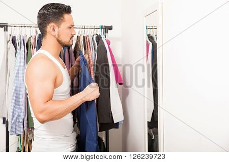 Young Man Trying On A Shirt