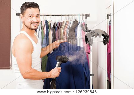 Young Man Steaming A Shirt In His Dressing Room