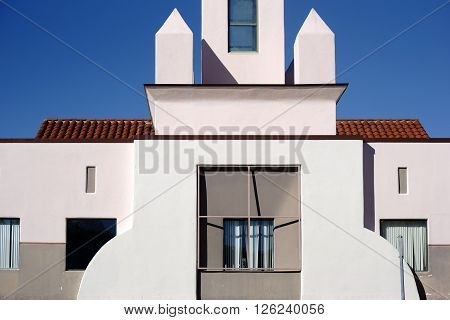SAN JUAN CAPISTRANO, UNITED STATES - DECEMBER 25: A tower and window facade of the San Juan Capistrano Library in sunny weather on December 25 2015 in San Juan Capistrano.