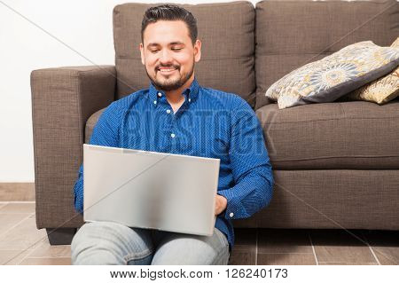 Happy Guy Working From Home On A Laptop