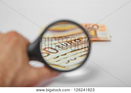 Magnifying Glass on the fifty Euros on isolated background