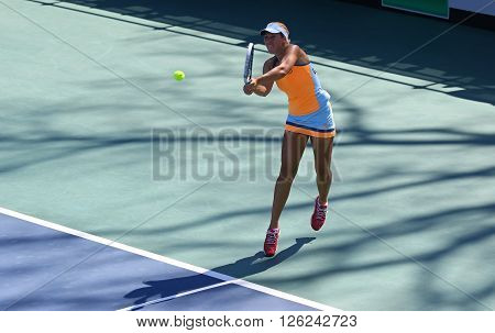 KYIV UKRAINE - APRIL 17 2016: Olga Savchuk of Ukraine in action during BNP Paribas FedCup World Group II Play-off pair game against Argentina at Campa Bucha Tennis Club in Kyiv Ukraine