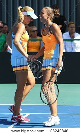 KYIV UKRAINE - APRIL 17 2016: Kateryna Bondarenko and Olga Savchuk of Ukraine react during BNP Paribas FedCup match against Maria Irigoyen of Argentina at Campa Bucha Tennis Club in Kyiv Ukraine