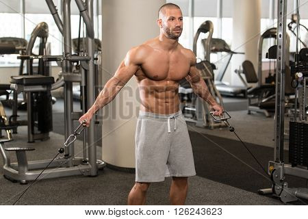 Bodybuilder Exercising Chest On Steel Cable
