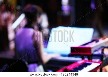 Musician playing the piano at the stage