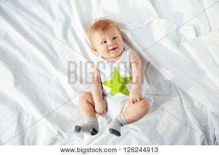 Little baby boy lying on the bed