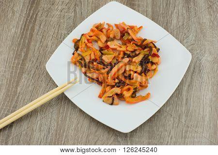 Squid Salad / Calamari Salad (Chuka Ika Sansai). Asian salad of squid with vegetables on a white plate