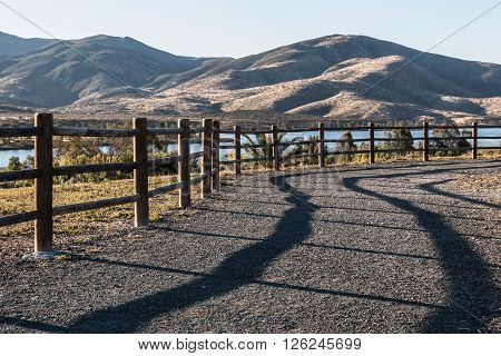 Pathway to lake and mountain range at Mountain Hawk Park in Chula Vista, California.