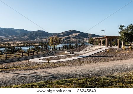 Early morning light on amphitheater with Lower Otay Lake and mountain range in the background at Mountain Hawk Park in Chula Vista, California.