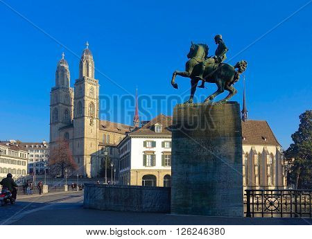 Zurich, Switzerland, December 8, 2015: The Hans Waldmann Statue, the Helmhaus and the Grossmuenster in Zuerich, Switzerland