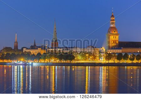 Old Town of Riga and River Daugava at night, Riga Cathedral, Cathedral Basilica of Saint James and Riga castle in the background, Latvia